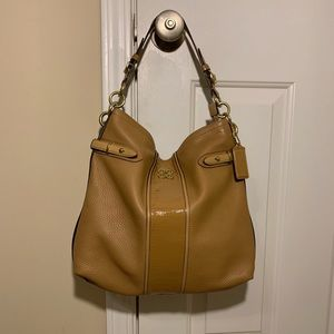 Slouchy tan leather coach purse